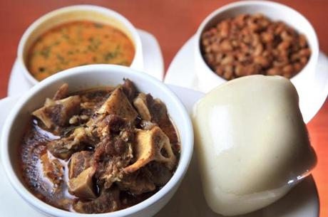 Oxtail pepper stew, with pounded yam fufu (right), taushe (back left), and stewed black-eyed peas (back right).